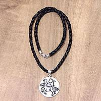 Leather and bone pendant necklace, 'Sagittarius' - Hand Carved Bone Sagittarius Pendant Leather Necklace