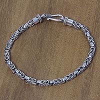Sterling silver braided bracelet, 'Sinnet' - Balinese Hand Crafted Sterling Silver Braided Bracelet