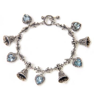 Blue topaz charm bracelet, 'Love's Melody' - Blue Topaz and Sterling Silver Heart and Bell Charm Bracelet