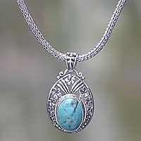 Sterling silver flower necklace, 'Frangipani Halo' - Sterling Silver Necklace with Turquoise Color Gem