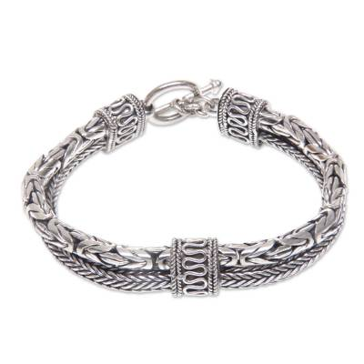 Sterling silver braided bracelet, 'Dragon Lore' - Sterling Silver Naga and Borobudur Braided Bracelet