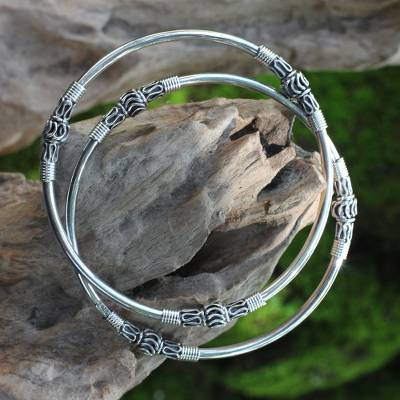 Sterling silver bangle bracelets, 'Kintamani Moon' (pair) - Artisan Crafted Sterling Silver Bangles (Pair)