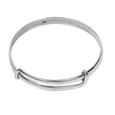 Sterling silver bangle bracelet, 'Tender Embrace' - Balinese Handcrafted Sterling Silver Bangle Bracelet