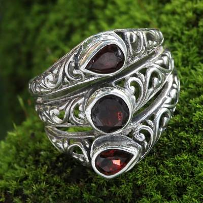 Garnet cocktail ring, 'Three Loves' - Three Stone Faceted Garnet and Silver Ring Crafted in Bali