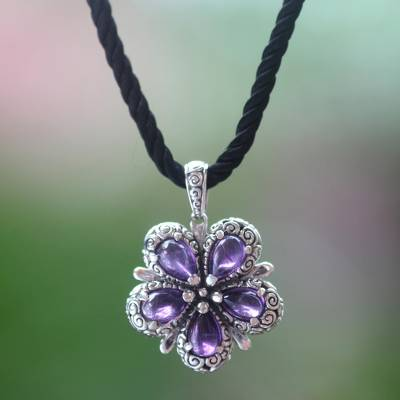 Amethyst pendant necklace, 'Mystic Frangipani' - Amethyst and Sterling Silver Flower on Black Silk Necklace