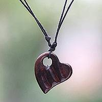 Wood pendant necklace, 'Gianyar Sweetheart' - Bali Artisan Crafted Sono Wood Heart Necklace