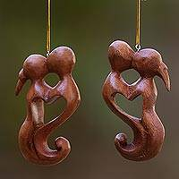 Wood ornaments, 'Kiss of Love' (pair) - Hand Carved Suar Wood Heart Ornament Paie of Kissing Couple