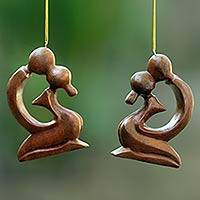 Wood ornaments, 'A Loving Kiss' (pair) - 2 Ornaments of Couple Kissing Hand Carved of Suar Wood