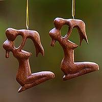 Wood ornaments, 'Gentle Touch of a Mother' (pair) - Playful Mother and Baby Ornaments Hand Carved Wood (Pair)