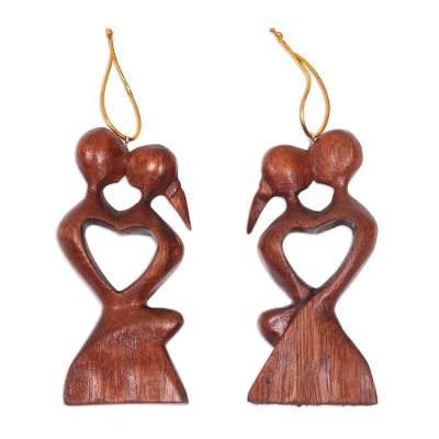 Wood ornaments, 'Kissing Heart' (pair) - Heart Shaped Hand Carved Wood Romantic Ornament Pair