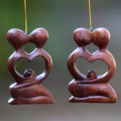Wood ornaments, 'Forever Together' (pair) - Two Heart Ornaments of Couple Kissing Hand Carved of Wood