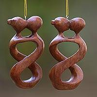 Wood ornaments, 'Spinning Kiss' (pair) - Set of 2 Kissing Lovers Wood Ornaments Hand Carved in Bali