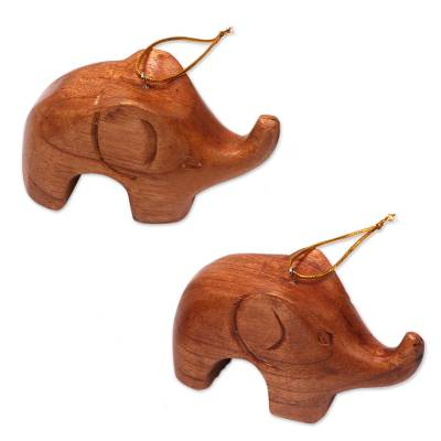 Wood ornaments, 'Little Brown Elephants' (pair) - Hand Carved Petite Brown Elephant Wood Ornament Pair