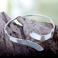 Silver plated bangle bracelet, 'Sensational' - Silver Plated Brass Bangle Bracelet Crafted by Hand