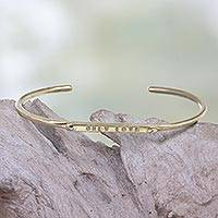 Brass cuff bracelet, 'Only Love' - Inspirational Brass Cuff Bracelet with Engraved Message