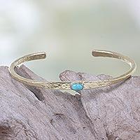 Brass cuff bracelet, 'Rustic Diva' - Artisan Crafted Brass Cuff Bracelet with Blue Stone