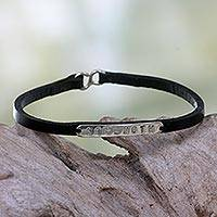 Leather wristband bracelet, 'Inherent Strength' - Leather Wristband Bracelet with Inspirational Message