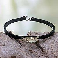 Leather wristband bracelet, 'Resilient Love' - Inspirational Leather Bracelet with Engraved Message