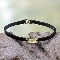 Leather wristband bracelet, 'XO' - Brass Hugs and Kisses on Black Leather Wristband Bracelet