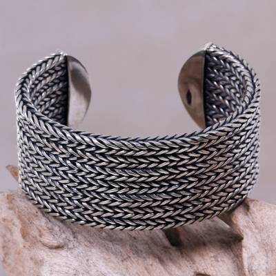 Sterling silver cuff bracelet, 'Horseshoe Braids' - Artisan Sterling Silver Cuff of oxidised Braids with Highly