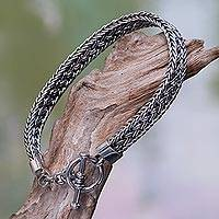 Sterling silver bracelet, 'Tukad Pakerisan' - Balinese Braided Sterling Silver Bracelet with Toggle Clasp