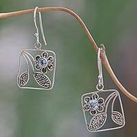 Blue topaz dangle earrings, 'Bali Daisy' - Handcrafted Indonesian Silver Blue Topaz Dangle Earrings