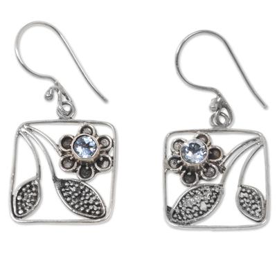 Blue topaz dangle earrings, 'Bali Daisy' - Handcrafted Indonesian Silver Blue Topaz Dangle Earrings