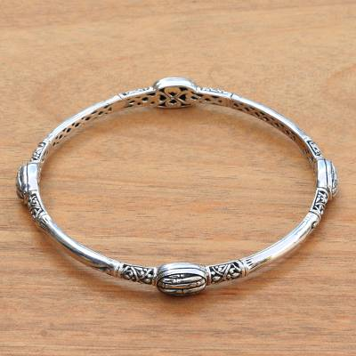 Sterling silver bangle bracelet, 'Bamboo Station' - Artisan Crafted Sterling Silver Engraved Bangle Bracelet