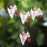 Wood ornaments, 'Celebrating Angels' (set of 4) - Set of Four Wooden Dancing Angel Ornaments with Hearts