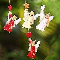 Wood ornaments, 'Dream Angels' (set of 4) - Artisan Crafted Set of 4 Wood Angel Ornaments from Bali