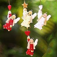 Wood ornaments, 'Dream Angels' (set of 4) - Artisan Crafted Set of 4 Wood Angel Ornaments from Bali