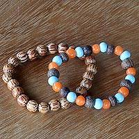 Beaded stretch bracelets, 'Bangli Dawn' (pair) - Artisan Crafted Ceramic and Wood Bead Bracelets (Pair)
