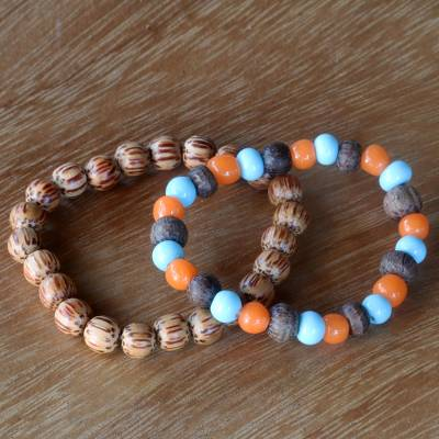 Beaded stretch bracelets, 'Bangli Dawn' (pair) - Artisan Crafted Ceramic and Wood Bead Bracelets (Pair)