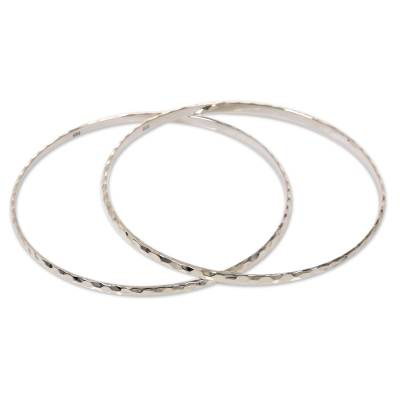 Sterling silver bangle bracelets, 'Sterling Circles' (pair) - Women's Bangle Bracelets from Bali in Sterling Silver (Pair)