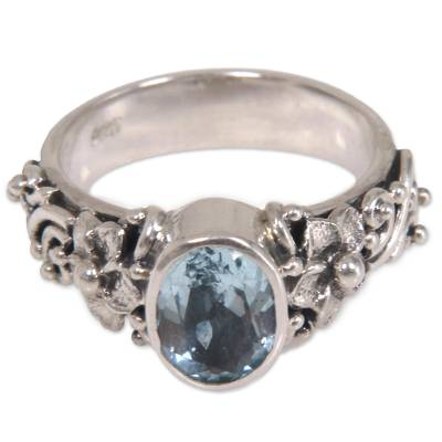 Blue topaz single stone ring, 'Frangipani Path' - Oval Cut Blue Topaz and Silver Ring with Floral Design
