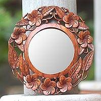 Wood mirror, 'Frangipani Bouquet' - Hand Carved Suar Wood Round Mirror with Floral Motif
