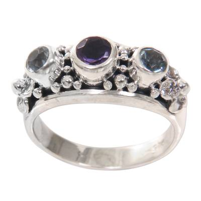 Amethyst and blue topaz cocktail ring, 'Seminyak Blossoms' - Amethyst and Blue Topaz Sterling Silver Floral Ring