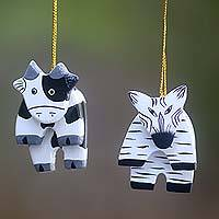 Wood ornaments, 'Zebra and Cow' (pair)