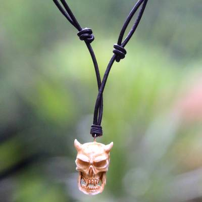 Bone and leather necklace, 'Demon King' - Handmade Cow Bone and Leather Devil Skull Necklace from Bali