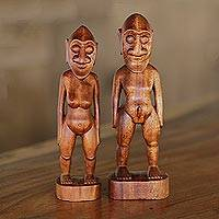 Wood sculptures, 'Ancient Asmat' (pair) - Pair of Suar Wood Man and Woman Sculptures from Bali