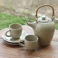 Ceramic tea set, 'Perasi Sands' (set for 2) - Sleek Ivory Ceramic Teapot with 2 Cups and 2 Saucers