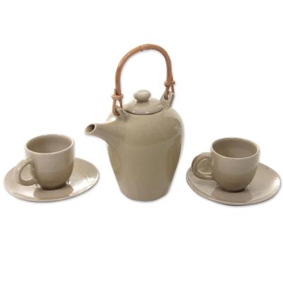 Ceramic tea set, 'Perasi Sands' (set for 2) - Sleek Ivory Ceramic Teapot with 2 Cups and 2 Saucers