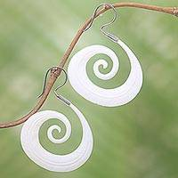 Bone dangle earrings, 'Feather Spiral' - Silver Hook Hand Carved Bone Earrings with Feather Theme