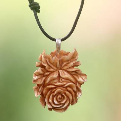Cow bone and leather pendant necklace, 'Brown Rose' - Handmade Floral Cow Bone Pendant on Leather Cord Necklace