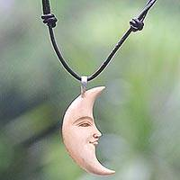 Bone and leather pendant necklace, 'Serene Crescent Moon' - Hand Carved Balinese Moon Necklace in Leather and Bone