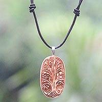 Bone and leather pendant necklace, 'Sacred Banyan Tree' - Leather Tree Theme Necklace with a Hand Carved Bone Pendant