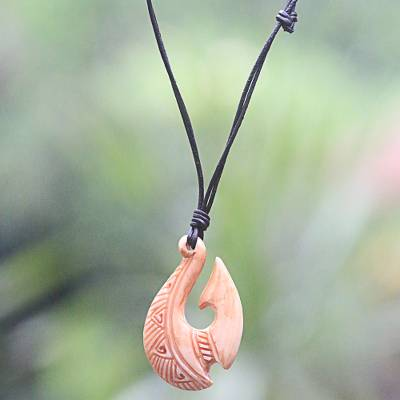 Bone and leather pendant necklace, 'Antique Fish Hook' - Black Bone Unisex Hand Carved Bone Necklace