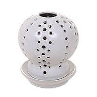 Ceramic candle holder and oil warmer, 'White Globe' - White Ceramic Candle Holder with Circle Cutouts