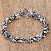 Sterling silver chain bracelet, 'Spiral Bound' - Artisan Crafted Sterling Silver Bracelet with Rope Motif