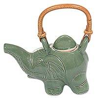 Ceramic tea pot, 'Cute Elephant' - Artisan Crafted Ceramic Elephant Teapot with Rattan Handle